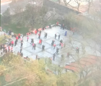 The dancers outside in the freezing cold... newly renovated park next to my building.