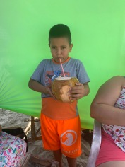Leo with a big coconut.